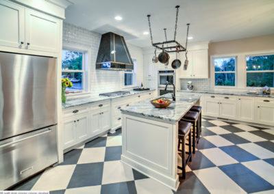 modern retro kitchen with black and white checkered floor