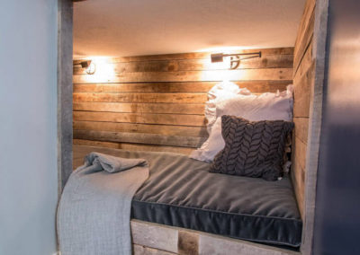 cozy nook under wood beams with wood plank surround