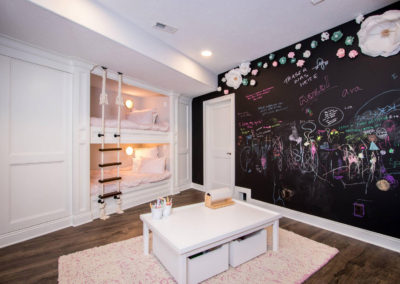 custom built in bunk bed room with chalkboard wall