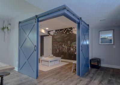 barn doors open to bunk room