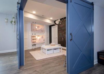 sliding blue barn doors to bunk bed room