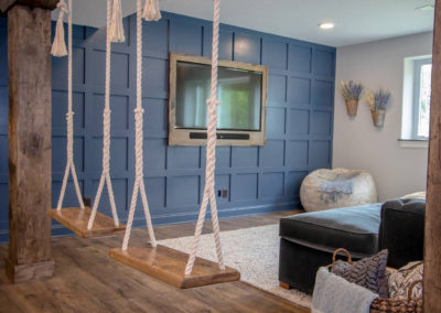 basement remodel with swings and entertainment area