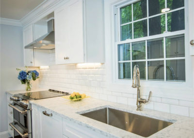 white kitchen with undermounted stainless steel sink