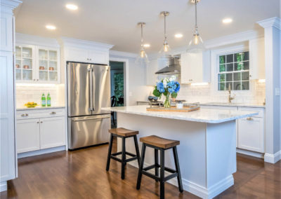 classic white kitchen with recessed lighting