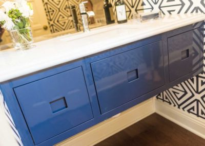 blue floating vanity with white countertop