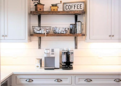 shaker style gray kitchen cabinets with wood shelves