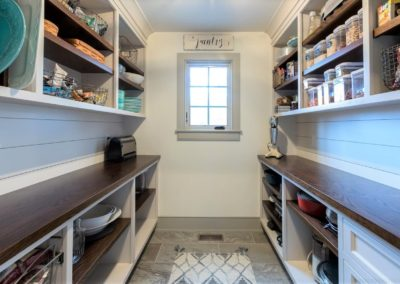 farmhouse pantry with built in shelving and wood countertops