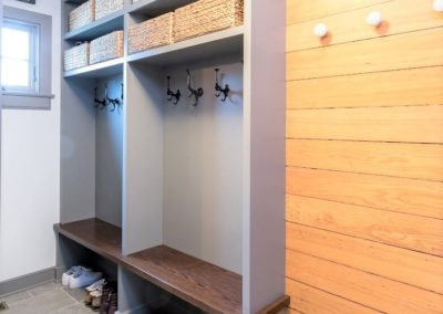 mudroom with built in benches and hooks