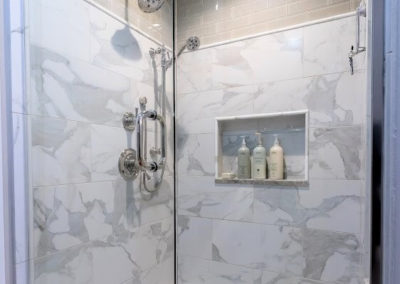 mixed gray tile shower with glass door