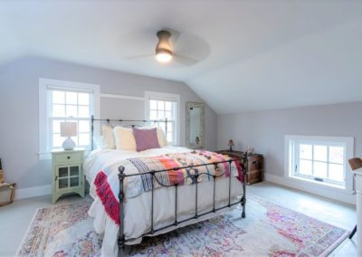 farmhouse bedroom with wrought iron frame bed