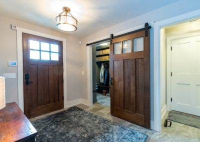 farmhouse foyer with craftsman wood doors