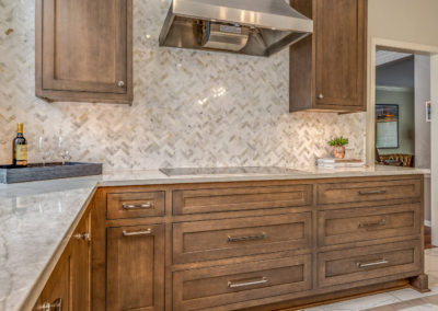 kitchen remodel with stainless steel stove range hood