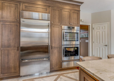 built in cabinets surrounding stainless steel fridge and double oven