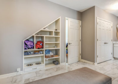 mudroom entry with built in shelving