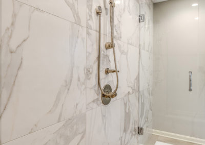 master bathroom shower with marble tile