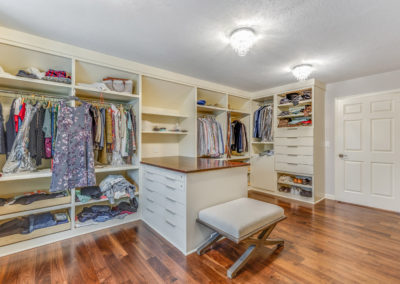 spacious master closet remodel with wood floors
