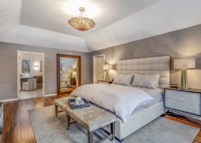 master bedroom remodel with tray ceiling and gray patterned wallpaper