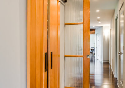 sliding wood doors leading to closet