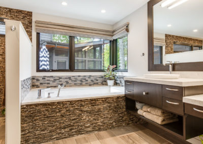 master bathroom tub with stone and tile details