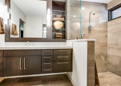 floating brown single sink vanity next to tile shower