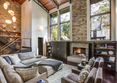 modern industrial living room with stone fireplace surround