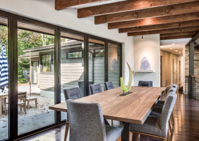 modern dining room with wood beams