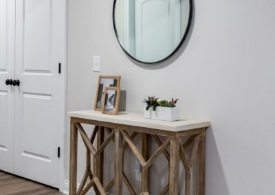 entryway table with circular mirror