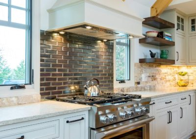 stainless steel oven and gas range in remodeled kitchen