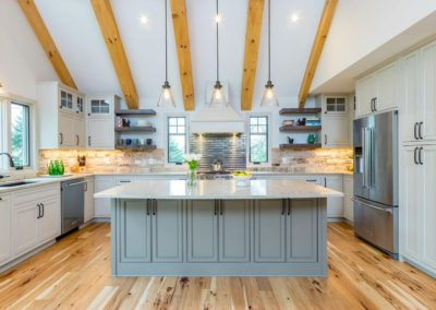 two toned kitchen with hickory hardwood flooring and beams
