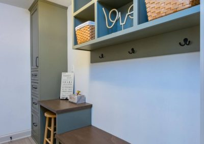 dark gray mudroom cabinets with built in bench