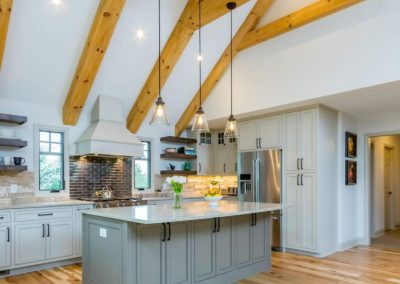 two toned kitchen renovation with exposed wood beams