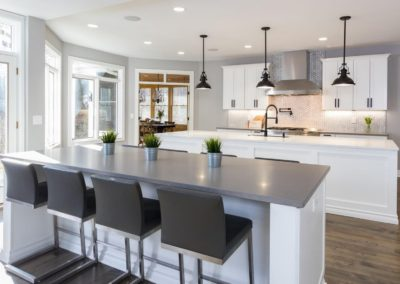 remodeled white kitchen with double islands