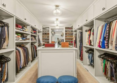 remodeled master closet with long center island