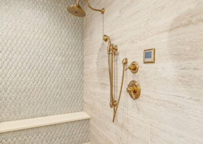 spacious walk in shower with dual gold showerheads