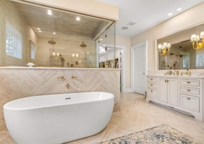 freestanding tub next to walk in shower in master bathroom