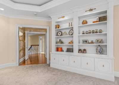 master suite white built in shelving and cabinets