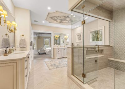 spacious master bathroom with separate vanities and walk in shower