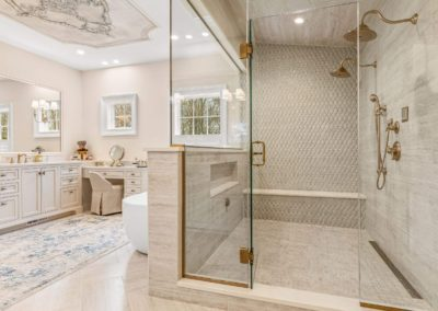walk in shower with bench and dual showerheads