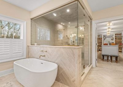renovated master bathroom open to spacious walk in closet