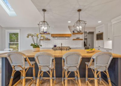 seating island with butcher block counters and pendant lighting