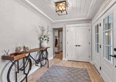 renovated farmhouse entry with bicycle table