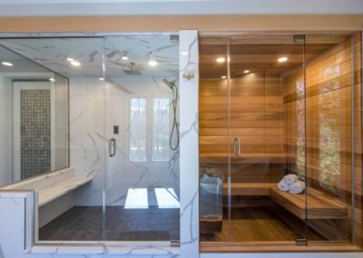 side by side walk in shower and sauna with glass doors