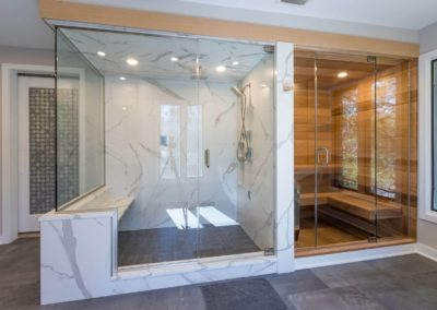 remodeled master bathroom with side by side walk in shower and sauna