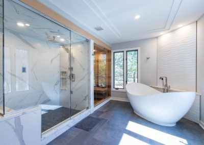 remodeled master bath with freestanding tub and large walk in shower