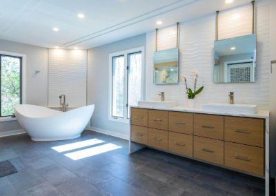 freestanding tub in master bathroom with double sink vanity