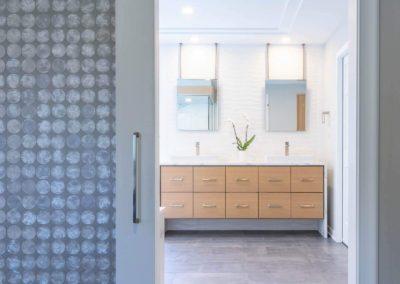 open door looking into master bathroom with double sink vanity