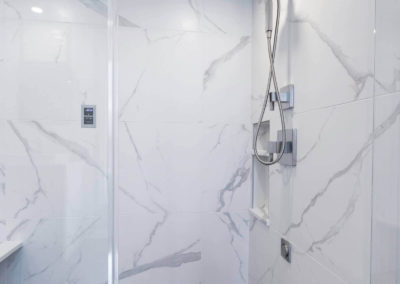 remodeled master bathroom shower with double shower heads
