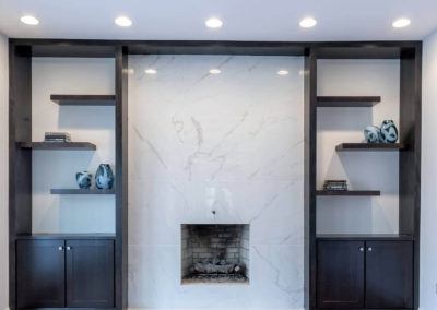 modern marble fireplace with built in shelves