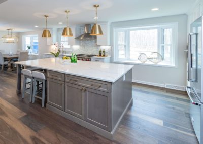 colonial kitchen with bay window and large storage island