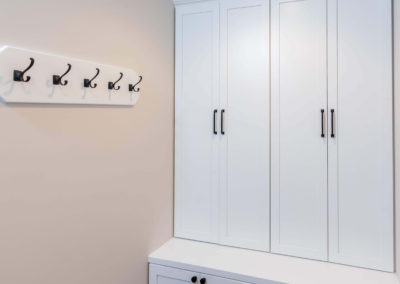 mudroom with white built in cabinets